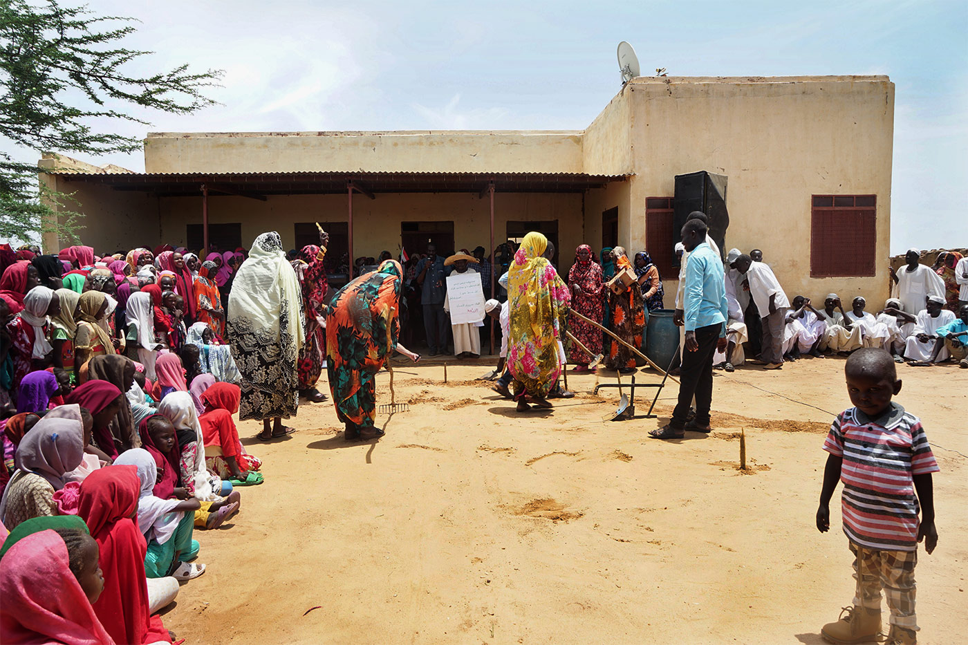 A community celebrating the reversal of desertification in the village of Majhoub, Sudan